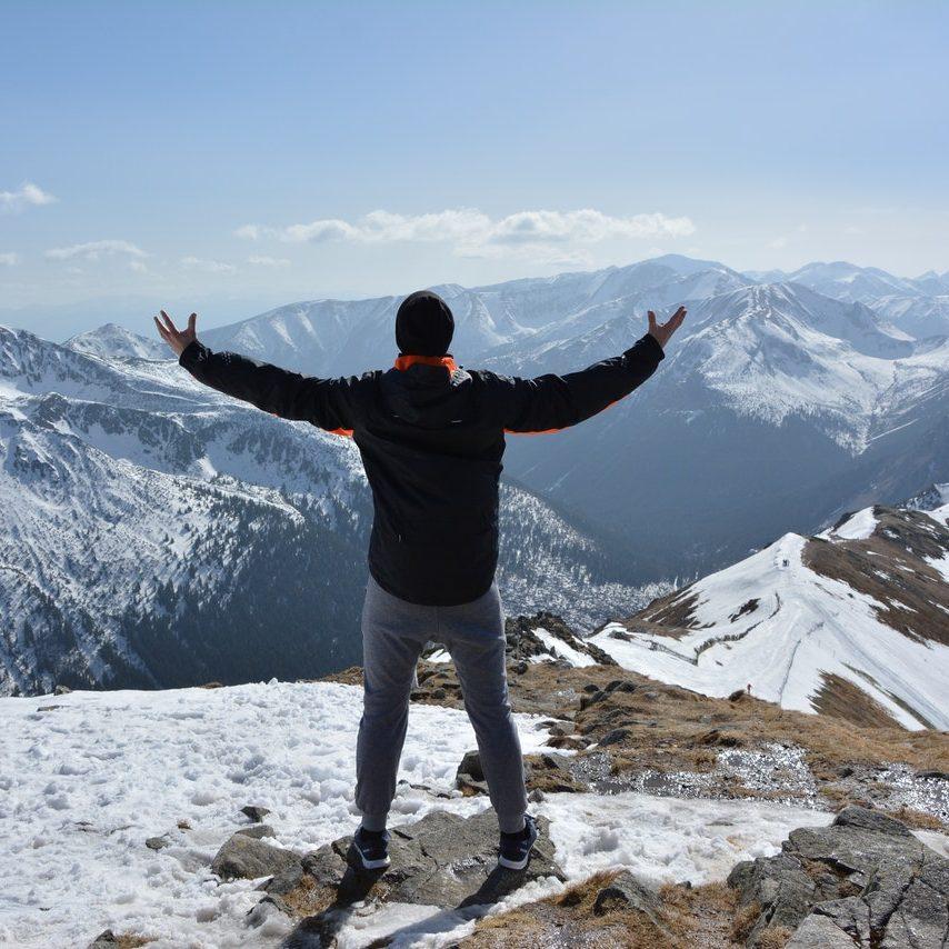 man-standing-on-mountain-2197902